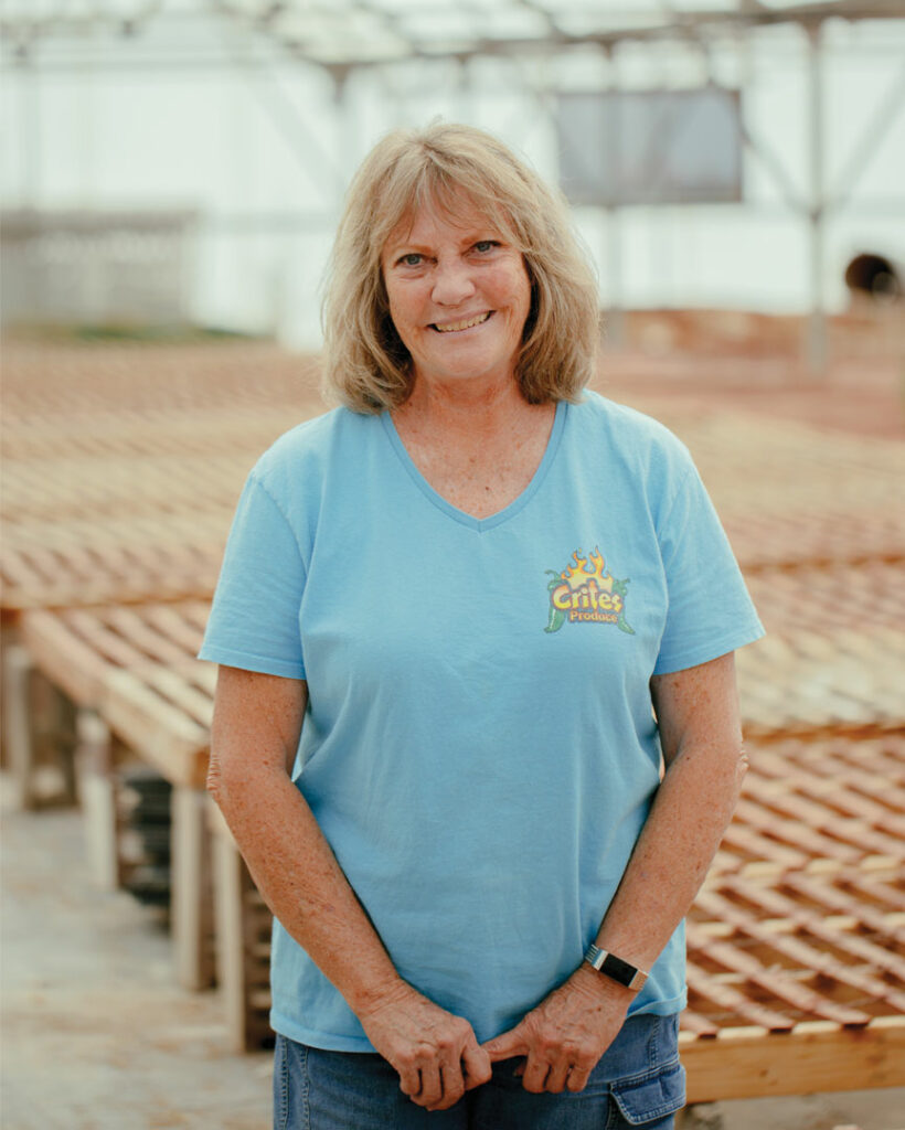Woman standing in a blue shirt