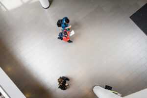Overhead shot of students walking through a building.