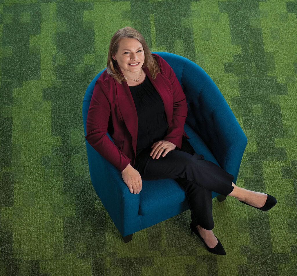 Top down view of a woman sitting in a blue chair.