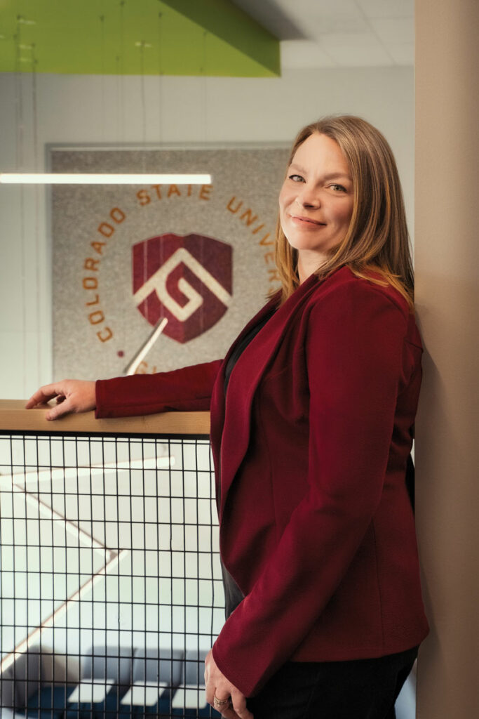 Woman in red in front of the CSU Global logo