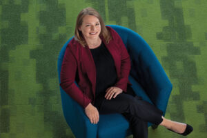 Overhead shot of woman sitting in a blue chair