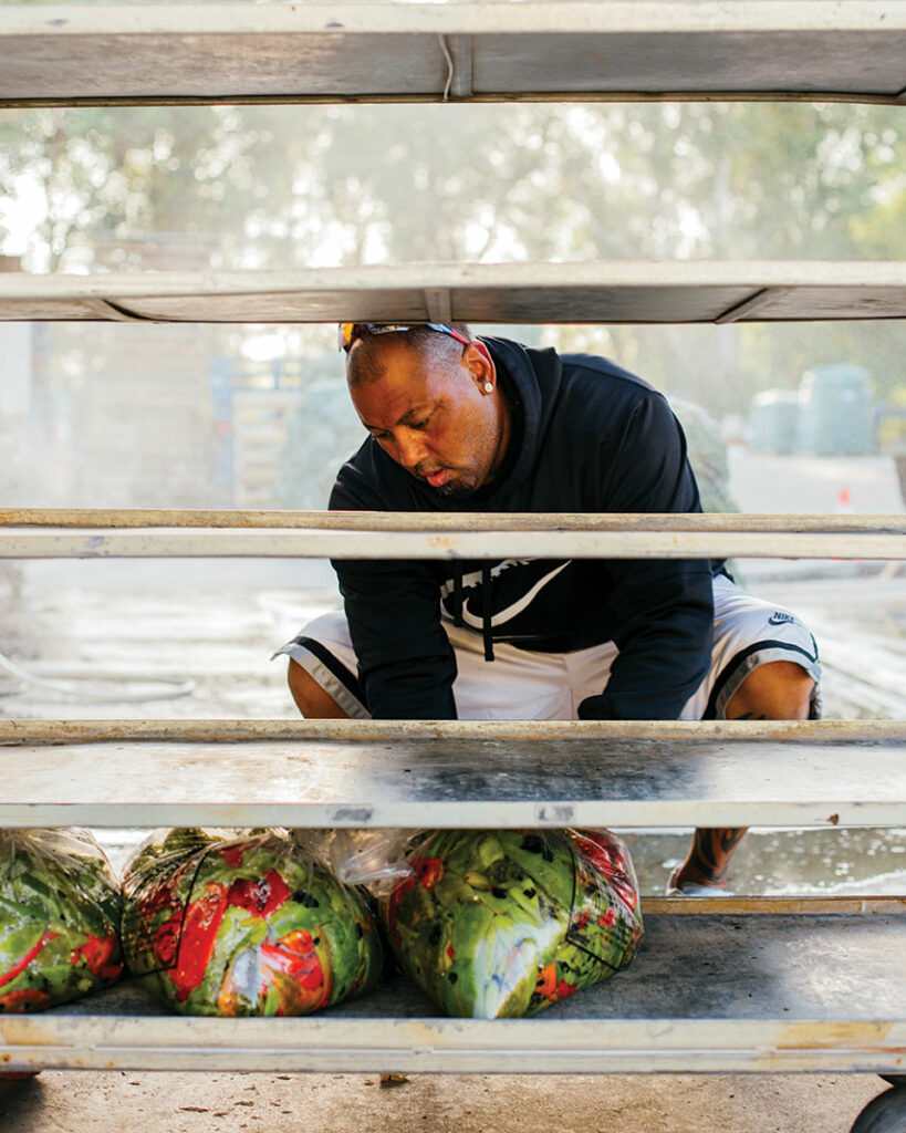 Man sits and bags chiles